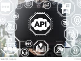 API (Application Program Interface) Cloud Technology. Man keep laptop with cloud api icon on virtual graphical user screen.